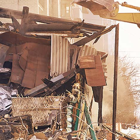 image of a structure being torn down by a bull dozer