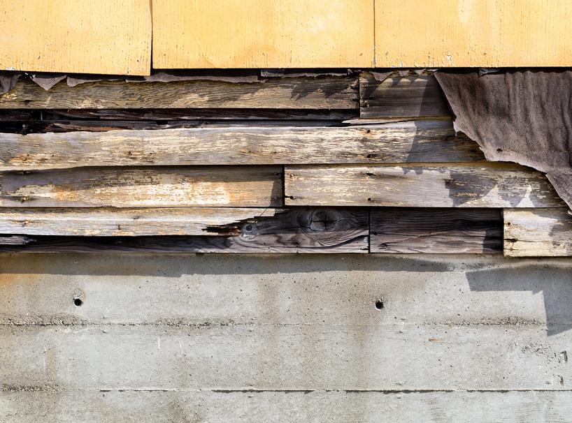 Asbestos siding falling apart due to age
