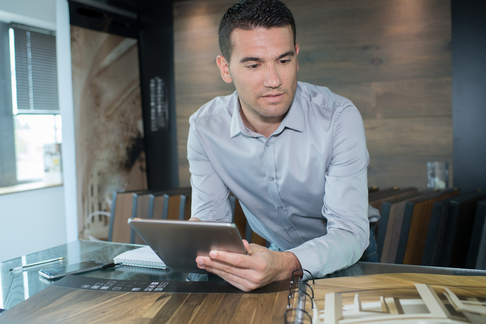 business man on tablet